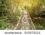 asian girl on the old bridge in ... | Shutterstock . vector #515373121