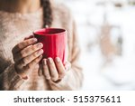 Woman's Hand Holding A Red Cup...