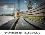 wooden bench in local park.... | Shutterstock . vector #515389279
