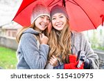 young women holding red... | Shutterstock . vector #515410975