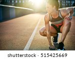 woman kneels with one hand on... | Shutterstock . vector #515425669