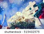snow falling on snowman closeup ...   Shutterstock . vector #515432575