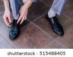 groom tying shoelaces | Shutterstock . vector #515488405