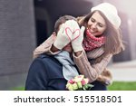 Stock photo picture showing young couple with flowers dating in the city 515518501