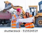 engineers examining plans on... | Shutterstock . vector #515524519