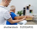 physiotherapist treating a man... | Shutterstock . vector #515526931