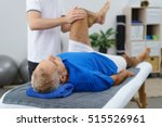 physiotherapist working with an ... | Shutterstock . vector #515526961