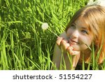 Girl with a Dandelion / against blue sky / freedom - stock photo