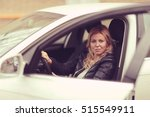 Middle Aged Woman Driver At Th...