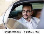 businessman traveling in a car  | Shutterstock . vector #515578759
