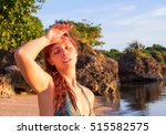 sunstroke at the beach. young... | Shutterstock . vector #515582575