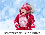 baby playing with snow in... | Shutterstock . vector #515640895