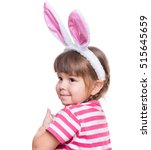Small photo of Happy little girl with pink rabbit ears. Portrait of cute caucasian baby wearing bunny ears. Funny preschool child, isolated on white background. Healthy carefree kid - Easter holidays concepts.