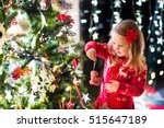 little girl in red knitted... | Shutterstock . vector #515647189