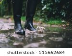 woman in black rubber boots... | Shutterstock . vector #515662684