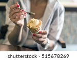 girl holding spoon with ice... | Shutterstock . vector #515678269