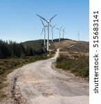 Small photo of Eolic wind generators on top of hills in Portugal.