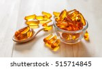 fish oil capsules on wooden... | Shutterstock . vector #515714845