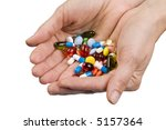 giving pills to patient. photo