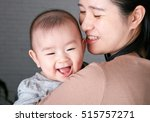 asian young mother holding a... | Shutterstock . vector #515757271