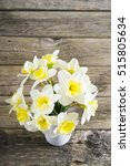 white daffodils at china vase... | Shutterstock . vector #515805634