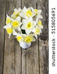 white daffodils at china vase... | Shutterstock . vector #515805691