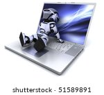 3D Render of a robot relaxing on a  laptop - stock photo