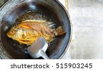 freshwater fish fried in a pan | Shutterstock . vector #515903245