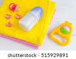 baby bottle with milk and towel ... | Shutterstock . vector #515929891