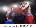 boxers fighting in boxing ring | Shutterstock . vector #515930191