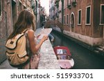 traveler girl looks at the map... | Shutterstock . vector #515933701