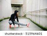 Sporty Woman Stretching And...