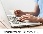 male hands holding credit card... | Shutterstock . vector #515992417