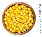 Small photo of Sweet corn kernels in wooden bowl over white. Cooked canned yellow vegetable maize, Zea mays, also called sugar or pole corn, a vegetarian staple food. Isolated macro food photo close up from above.