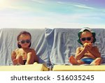 two cool boys sunbathing on... | Shutterstock . vector #516035245