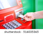 hand inserting atm card into... | Shutterstock . vector #516035365