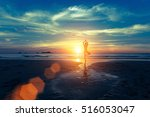 Yoga Silhouette At Sunset On...