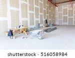 wheelbarrow is in front of... | Shutterstock . vector #516058984