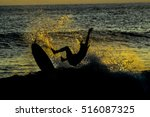 Silhouette Surfer At Sunset In...