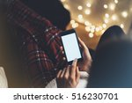 hipster girl using phone in a... | Shutterstock . vector #516230701
