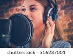 Woman Recording Audiobook. Audio Recording Studio Theme. Caucasian Voice Talent. - stock photo