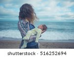 a young mother is standing on... | Shutterstock . vector #516252694