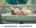 a newborn child in the hospital | Shutterstock . vector #516260941