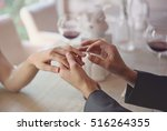 man making marriage proposal to ... | Shutterstock . vector #516264355