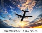 airplane in sunset sky.  | Shutterstock . vector #516272371