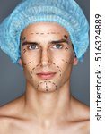 Small photo of Handsome man in medical hat with pencil marks on skin for cosmetic surgery, ready for operation. Aesthetic Cosmetology concept
