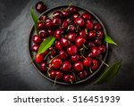 Fresh Cherry On Black Plate On...