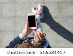 woman using smartphone    Shutterstock . vector #516531457