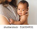 mother holding cute newborn... | Shutterstock . vector #516534931