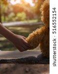 a little girl and teddy bear... | Shutterstock . vector #516552154